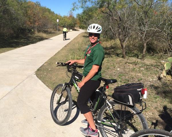 SA Parks and Recreation Trail Steward Marika Misangyi prepares for a bike ride north along the Leon Creek trail. Photo by Katherine Nickas.