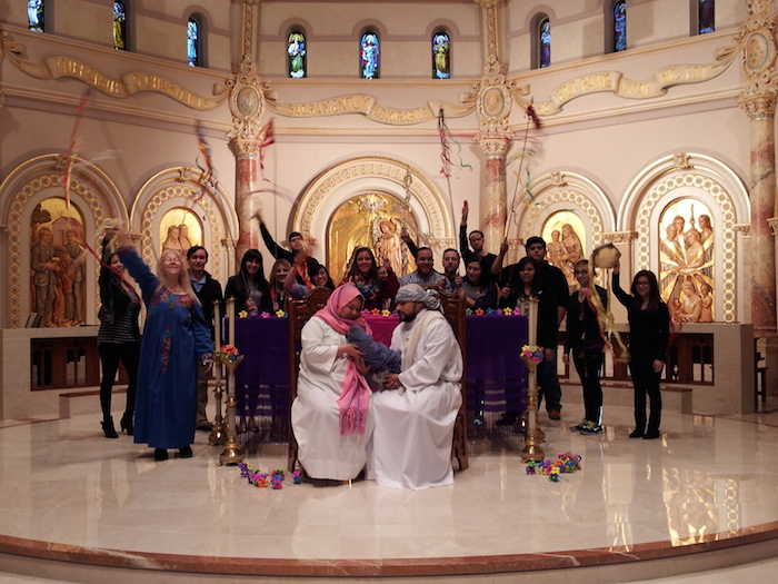 Remembering that through the centuries Christians have danced as well as sung Christmas carols to celebrate the birth of love and hope, students circled around Jesus, Mary, Joseph.