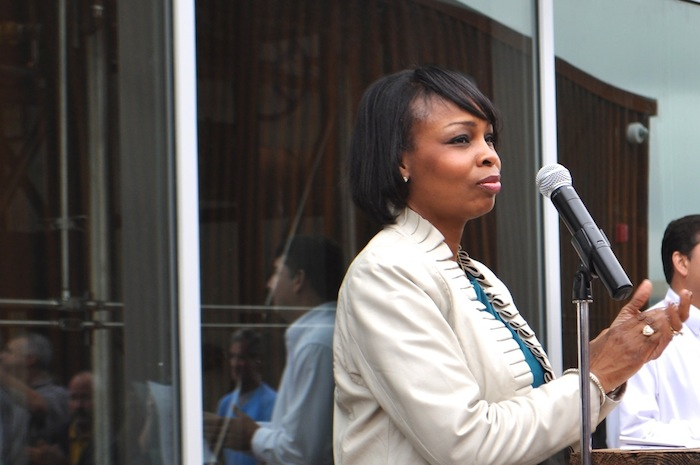 Mayor Ivy Taylor speaks to the large crowd gathered at the brewery's ribbon cutting ceremony. Photo by Iris Dimmick.