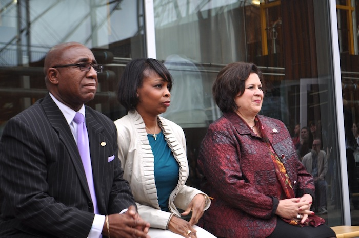 From left: District 2 Councilmember Keith Toney, Mayor Ivy Taylor, and Leticia Van de Putte listen to fellow speakers during the Alamo Beer Company brewery ribbon-cutting. Photo by Iris Dimmick.