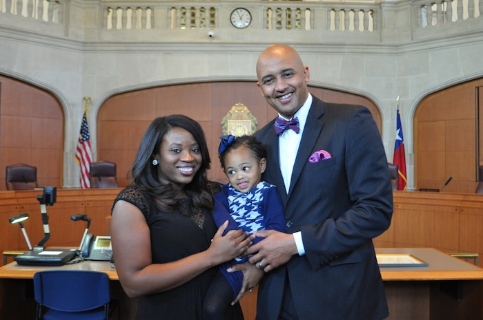 District 2 Councilmember Alan Warrick stands with his wife, Tia, and 2-year-old daughter Avry. Photo by Iris Dimmick.