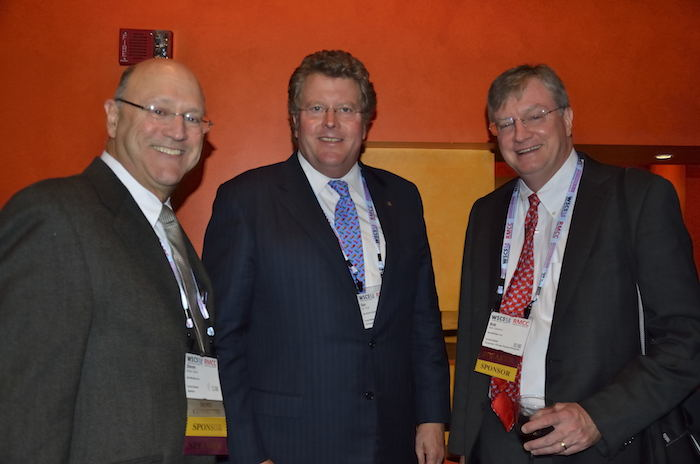 Dr. Steven Davis, co-founder of StemBioSys, Don Frost, vice chairman of San Antonio Economic Development Foundation, and Bob Hutchens, CEO of StemBioSys, visit during the Summit. Photo by Cherise Allegrini.