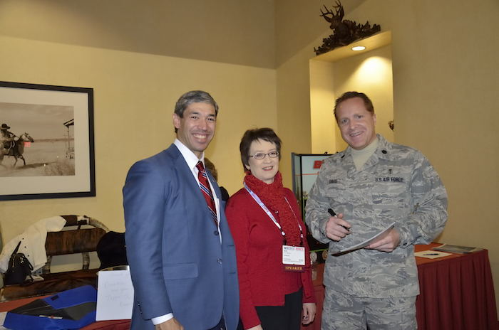 District 8 Councilman Ron Nirenberg, President of BioMed SA Ann Stevens,and Lt. Col. Mike Davis, deputy commander of USAISR, share a moment at the Summit. Photo by Cherise Allegrini.
