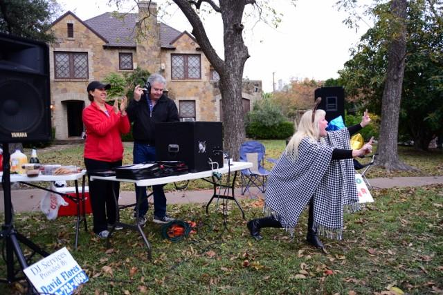 DJ David Flores plays the music while Joanna Dempoulis dances and encourages marathon participants. Photo by Page Graham.