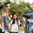 Students learn about bike maintenance during a Earn-A-Bike BScuela session. Photo by Rachel Chaney.