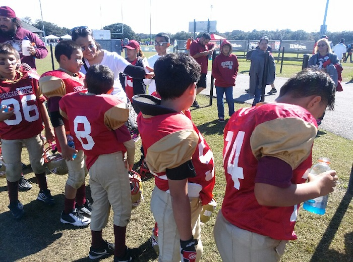 Cadet team huddles during halftime at the American Youth Football (AYF) 2014 National Championship. Photo courtesy of Seminoles Assistant Coach Hector Alvarado Jr.