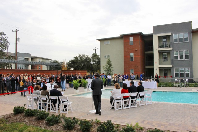 Ceremony attendees gather next to the swimming pool. Photo by Page Graham.