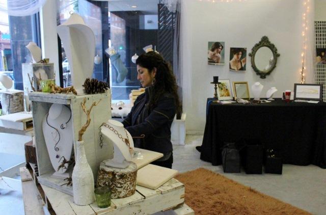 Joyarte owner Priscilla Martinez sets up her shop. Photo by Page Graham.