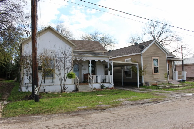 Houses like these in Dignowity Hill will ultimately be renovated. Photo by Page Graham.
