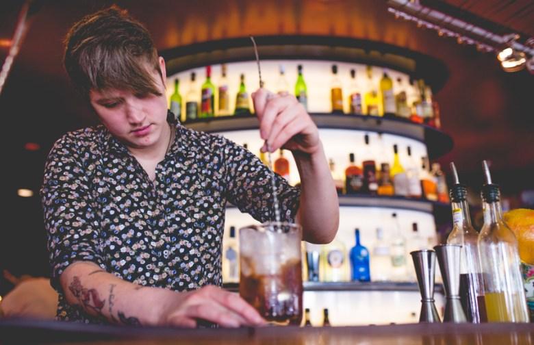 Karah Carmack mixes a Manhattan at Hot Joy.  Photo by Scott Ball.