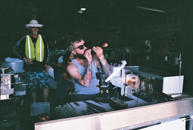 Jake Zollie Harper blowing glass during CAM 2014. Photo by Page Graham.