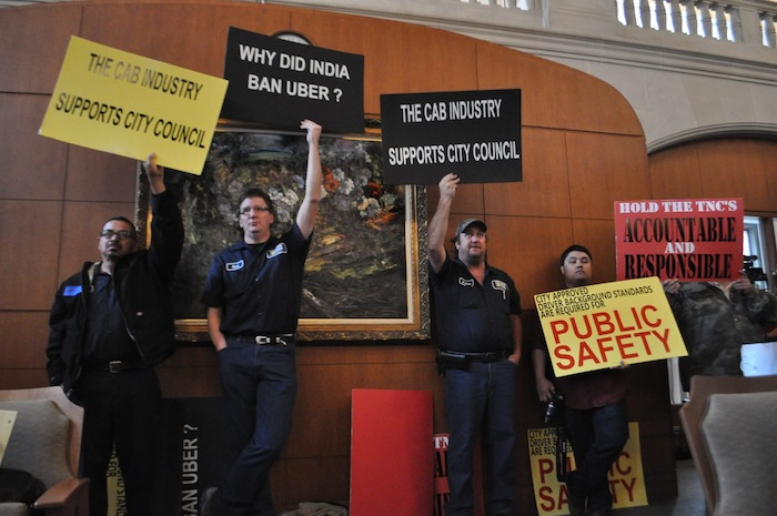 Cab drivers show up to oppose rideshare during a City Council meeting that resulted in approval of strict rideshare regulation in December 2014 that will take effect March 1, 2015. Photo by Iris Dimmick.