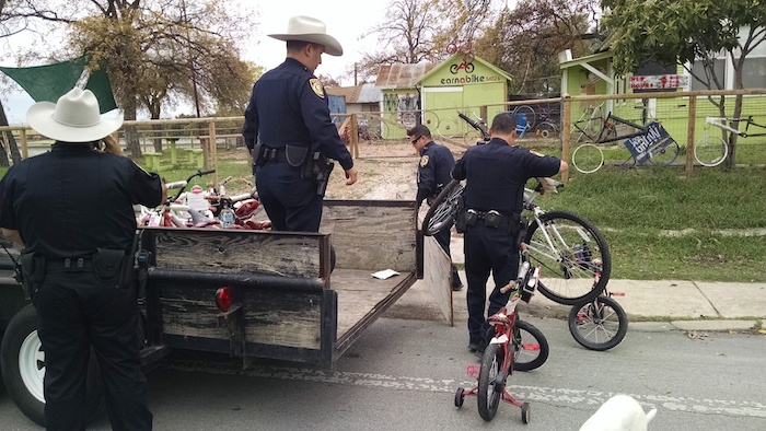 Members of the Bexar County Sheriff's Department deliver 50 bikes to Earn-A-Bike headquarters on the Westside. Courtesy photo.