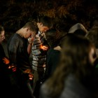 Cameron's brothers Ethan and William (center) bow their heads in prayer during a candlelight vigil on the one year anniversary of Cameron Redus' death. Photo by Scott Ball.