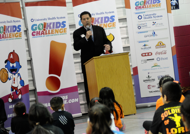 San Antonio Sports President and CEO Russ Bookbinder speaks to the kids for the Go!Kids Challenge pep rally at Rayburn Elementary School. Photo by Kristian Jaime.
