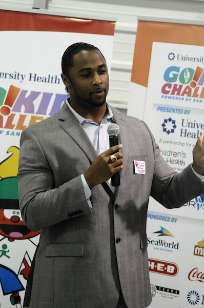 Former NFL player Tyreo Harrison speaks to the kids for the Go!Kids Challenge pep rally at Rayburn Elementary School. Photo by Kristian Jaime.