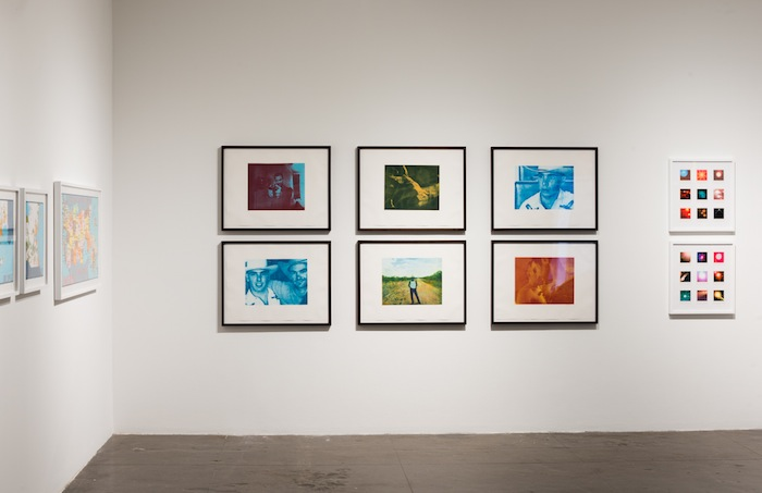 """Six color photogravures by Isaac Julien entitled """"After Mazatlan,"""" 1999, (left) and Dario Robleto's """"Shadows Evade the Sun I,"""" 2012, and """"Shadows Evade the Sun II,"""" 2012."""