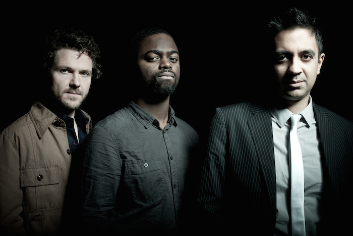 Stephan Crump, Marcus Gilmore, and Vijay Iyer form the Vijay Iyer Trio. Image courtesy of Juan Hitters/ECM Records.