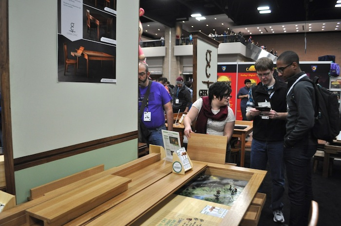 Geek Chic gaming furniture for sale during PAX South. This table is crafted specifically for tabletop gaming. Photo by Iris Dimmick.
