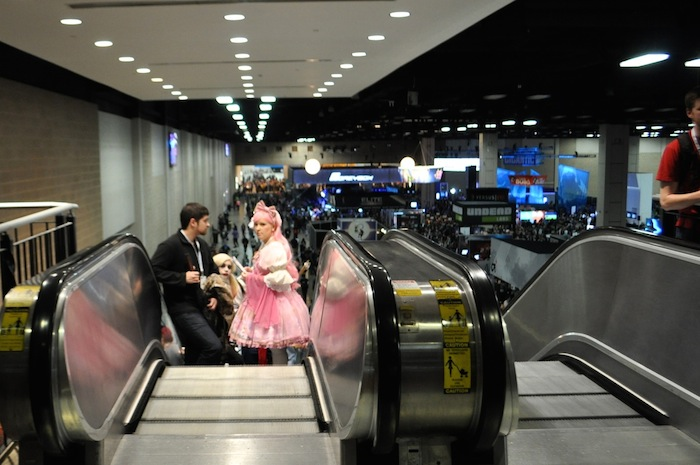 Attendees ride the escalator at the convention center during PAX South. Photo by Iris Dimmick.