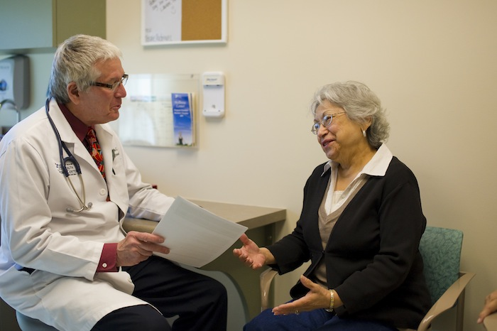 A physician talks with a patient at the Cancer Therapy and Research Center. Courtesy photo.