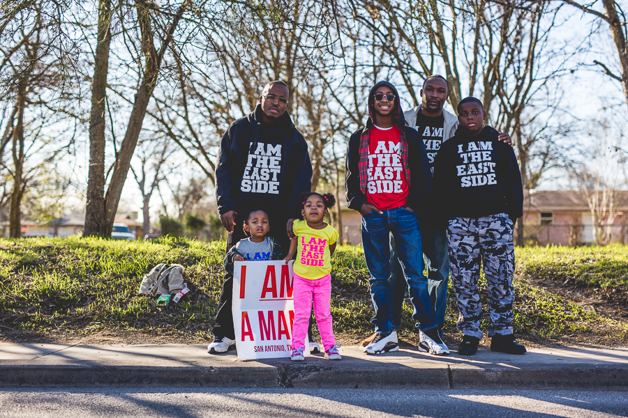 A family poses for a photo during the 2015 MLK March. Photo by Scott Ball.