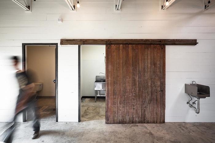 Merit Roasting Co.'s building features reclaimed lumber and other materials.Photo by Scott Martin.