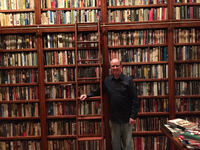 Judge Nelson Wolff poses for a photo in a library, you won't find his new book in these racks. Courtesy photo.