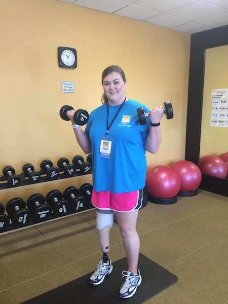 Tammlyn Niemietz works out in the weight room at the Hilton Hill Country during Fit Camp, a weeklong training session kicking off H-E-B's Slim Down Showdown. Image by Katherine Nickas.