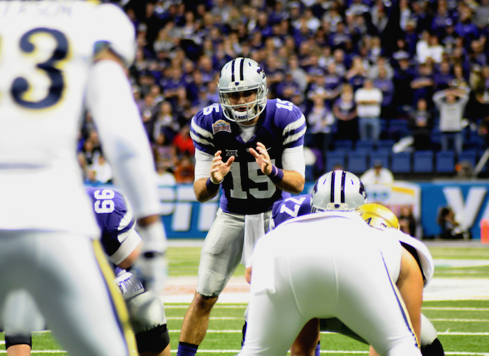 Quarterback Jake Waters gets ready for the snap during the second half of the 2015 Valero Alamo Bowl held on Jan. 2, 2015, at the Alamodome. Photo by Kristian Jaime.