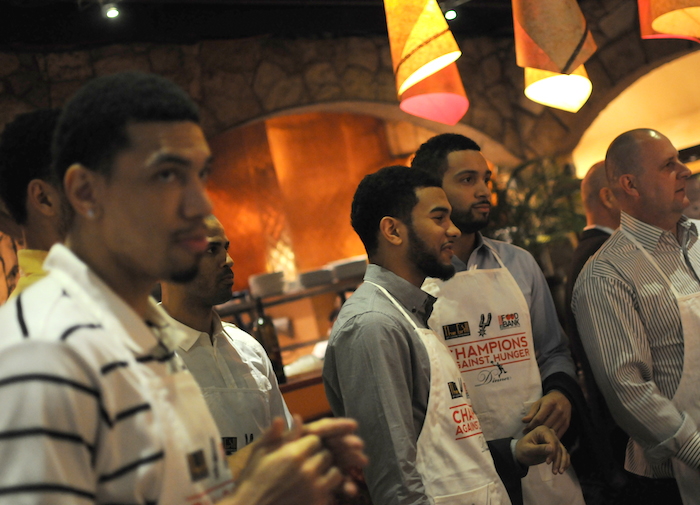 San Antonio Spurs players (from left) Danny Green, Cory Joseph, and Jeff Ayres get final instructions at the Fourth Annual Champions Against Hunger Fundraising Dinner held at the The Grill in Leon Springs. Photo by Kristian Jaime.