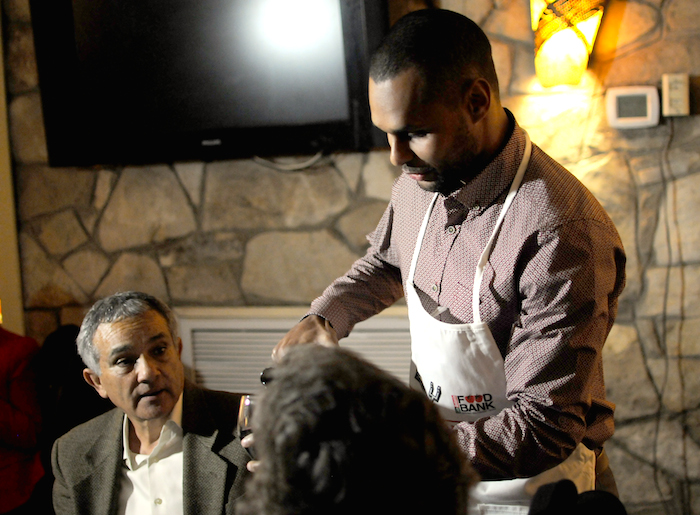 San Antonio Spur Patty Mills serves wine to guests during the Fourth Annual Champions Against Hunger Fundraising Dinner held at the The Grill in Leon Springs. Photo by Kristian Jaime.