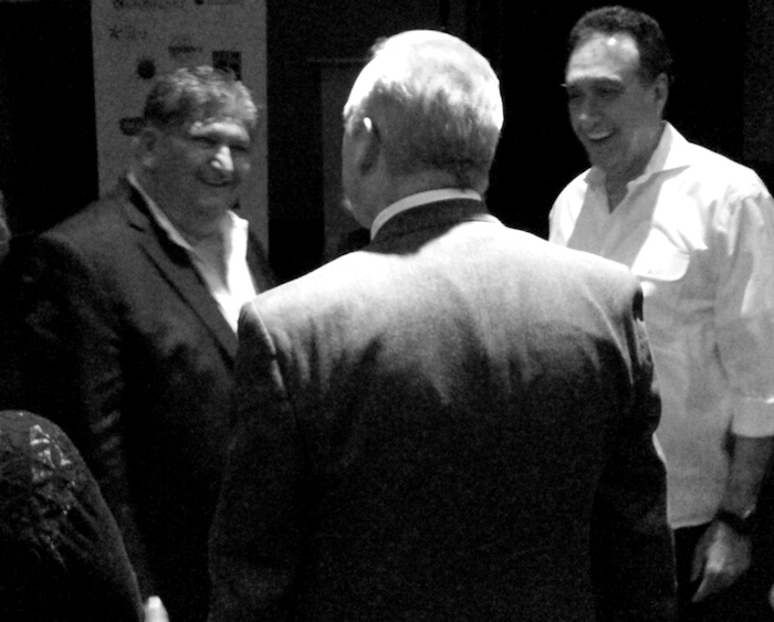 """Filmmaker Hector Galan (left) and former San Antonio Mayor Henry Cisneros (right) share a laugh with local singer Ken Slavin following a CineFestival screening of Galan's new documentary, """"Children of Giant,"""" on Saturday at the Guadalupe Theater. Photo by Edmond Ortiz."""