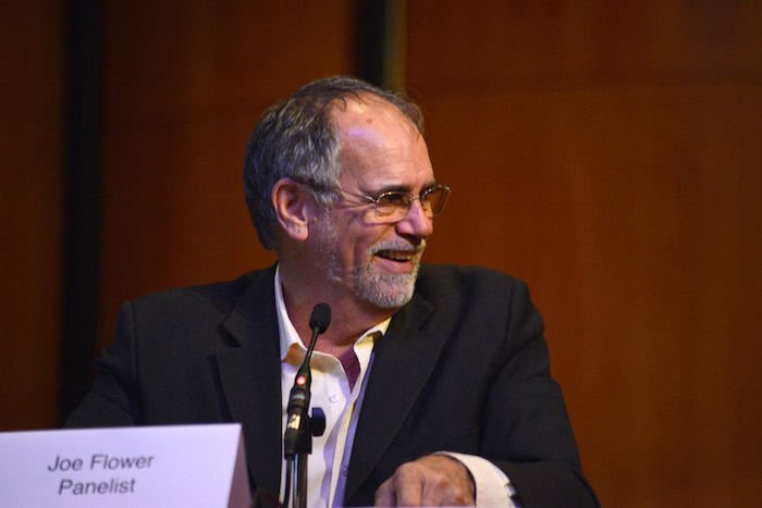 """Jow Flower, author of """"Healthcare Beyond Reform,"""" speaks at a panel during Trinity University's REACH Symposium. Photo courtesy Parish Photography."""