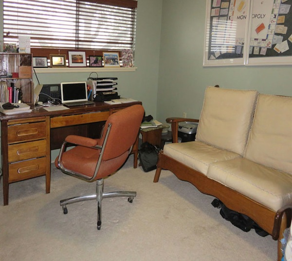Warren's home office. Desk is a 1950s vintage desk that he refinished, on the left corner is wine box crafted into a mini bookcase. Photos on window sill are some of his favorites. Warren's home office. Photo by  Warren Lieberman.