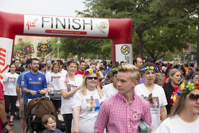 Family and friends participate in Any Baby Can's Superhero 5K. Photo courtesy of Any Baby Can.