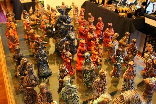 Figurines by Laurel Gibson, once displayed at the McNay, take over her dining room table. Photo by Page Graham.