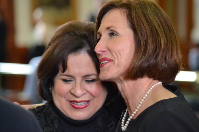 Outgoing Sen. Leticia Van de Putte talks receives a hug from Sen. Lois Kolkhorst after Van de Putte's farewell speech to the Texas Senate. Courtesy photo.