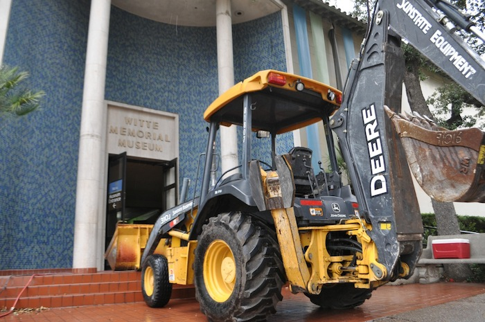 A backhoe guards the entrance of the Witte Museum. Photo by Iris Dimmick.