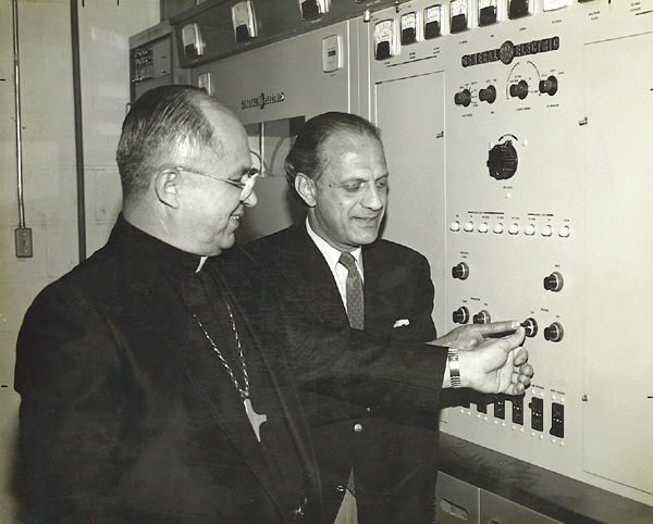 Archbishop Flores and Nicolas ceremonially press a transmitter button. The Chief Engineer is probably behind them fretting they'll actually do it. Photo courtesy sintv.org.