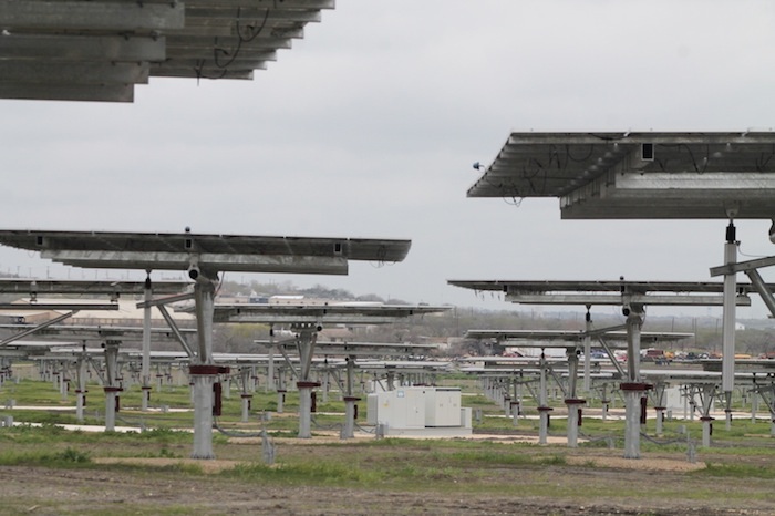 Without any sunlight, the panels at Alamo 3 remain stationary until the sun emerges. A KACO solar inverter is placed in the center, which converts direct current (DC) output into alternating current (AC). Photo by Amanda Lozano.