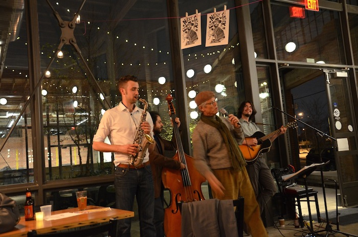Rudi Harst (center) joins the group for an improvised song about the night. Photo by Gretchen Greer.