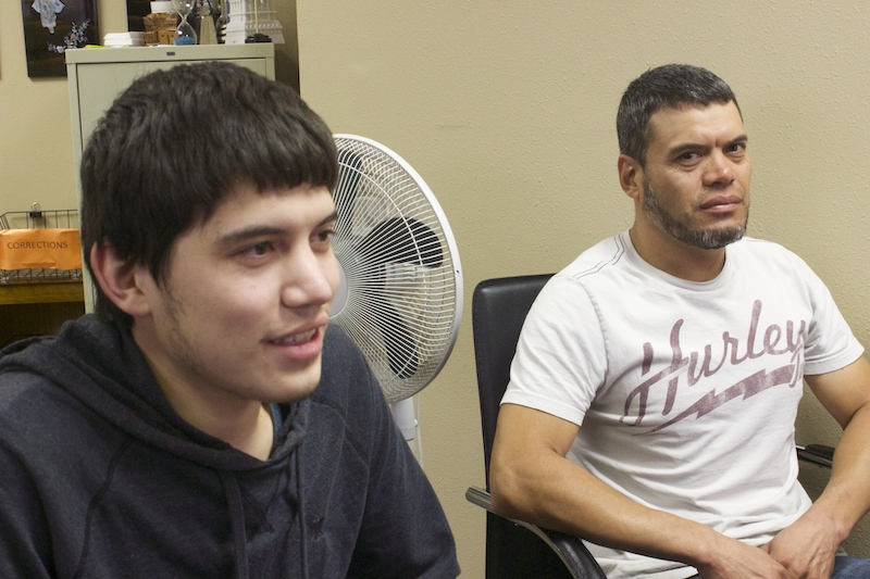 Hector Paez junior (left) and senior sit patiently at an immigration office. They were working on renewing Hector Jr.'s DACA application. Photo, by Amanda Lozano.