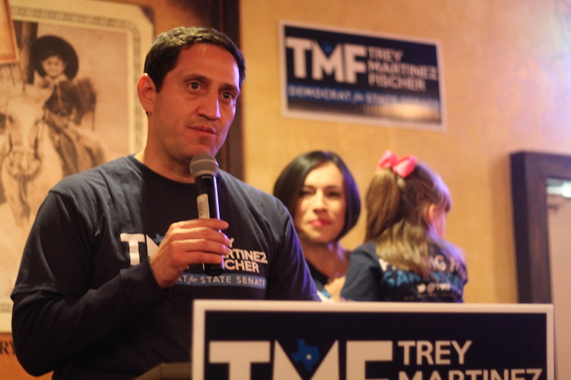 Trey Martinez Fischer addresses supporters during his concession speech. His wife Elizabeth stands behind him, holding their daughter, Francesca. Photo by Amanda Lozano.