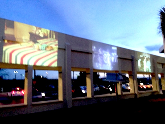 An art installation by Vincent Valdez lights up the interior of Nogalitos H-E-B facade. Photo by Wendy Weil Atwell.