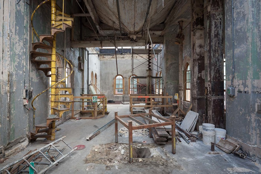 The Hopper Suite during demolition in 2013. Note the staircase, grain elevators and large hopper at the top that will all be featured in the suite in Hotel Emma. Photo by Scott Martin.