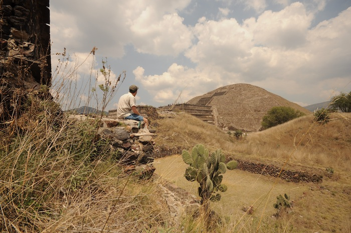 I sit in front of a view of the Pyramid of the Moon in Teotihuacán. Photo by Everett Redus.
