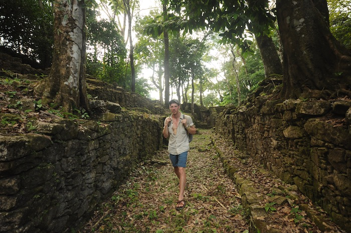 A photo of me walking through the Palenque ruins. Photo by Everett Redus.