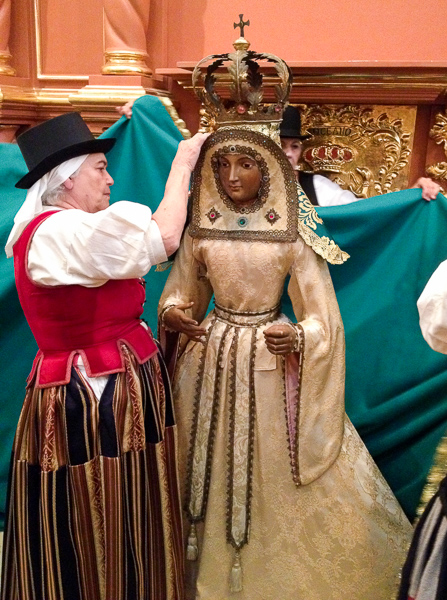 Members of the Canary Islands Descendents Association the new robe on the Virgin of Candelaria . Courtesy photo.