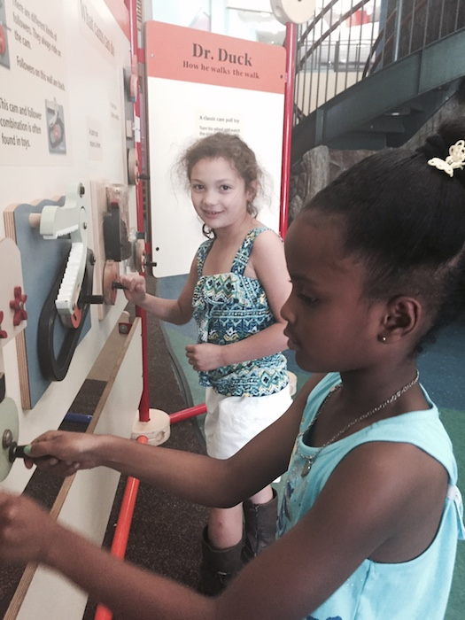 Analisa Clary, 7, left, and Mya Johnson, 6, play with one last exhibit before the Children's Museum closes for the last time. Photo by Tracy Hamilton.